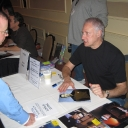 Brent Spiner signs a photo for a fan